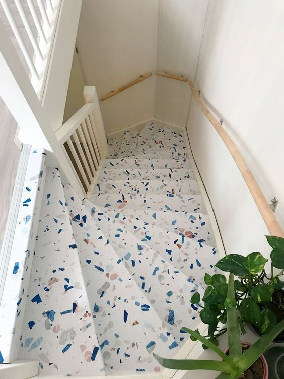 a staircase done with colorful terrazzo looks cheerful, bold and very cool and adds interest to all the spaces