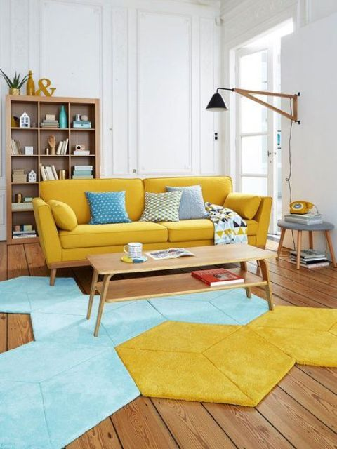 a vibrant living room with a yellow sofa, a geometric blue and yellow rug and stained wooden furniture is cool