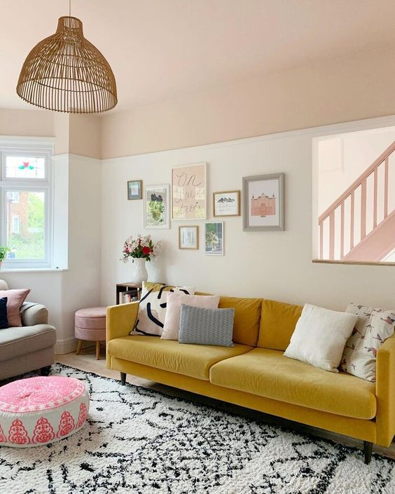 a vivacious living room with a yellow sofa, a lovely gallery wall, printed textiles and a rattan pendant lamp