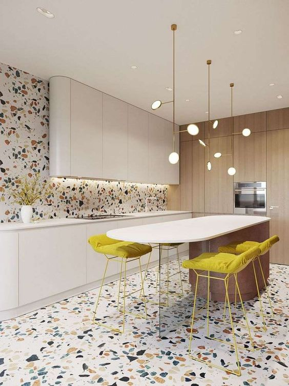 colorful terrazzo on the floor and wall adds interest and fun to this ultra-minimalist and refined kitchen