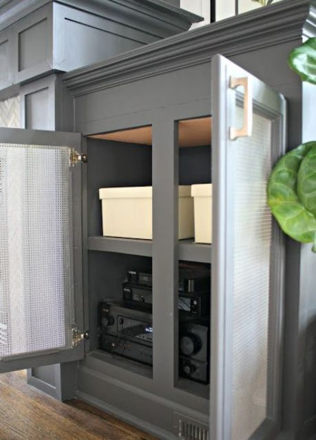 a cabinet with cane doors will hide your wi-fi router without blocking the signal, which is extremely important