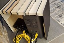 10 a box featuring fake books is a lovely space to hide any router or other electronics and looks very stylish
