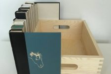 13 a crate with faux books attached to it can hide any electronics you want to hide, and will do it with elegance