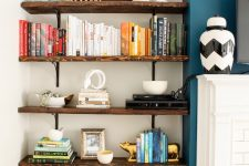 19 a router placed on a shelf makes part of decor like stacked books is a lovely idea to hide it right in the sight