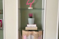 20 a simple popsicle stick screen with a touch of color is an easy DIY to hide your wi-fi router easily and make it look fine