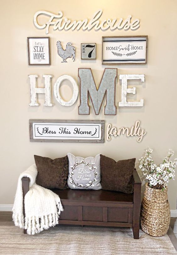 a cool rustic gallery wall with letters, framed signs, silhouettes and numbers is a pretty and cozy idea for an entryway