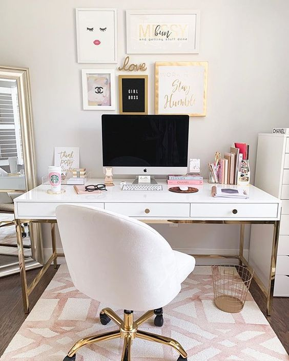 a fancy home office wiht neutral walls, a white and gold desk, a white chair, a chic gallery wall and a floor mirror is amazing