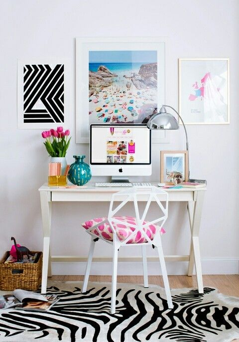 a cute simple home office with a trestle desk