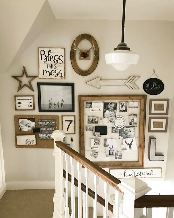 a large rustic gallery wall with family pics in frames, a memo board with photos and monograms, arrows and letters is cool