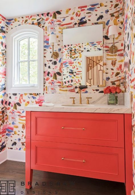 a maximalist bathroom with colorful watercolor walls, a red vanity, gold touches is a veyr refined, bright and chic idea