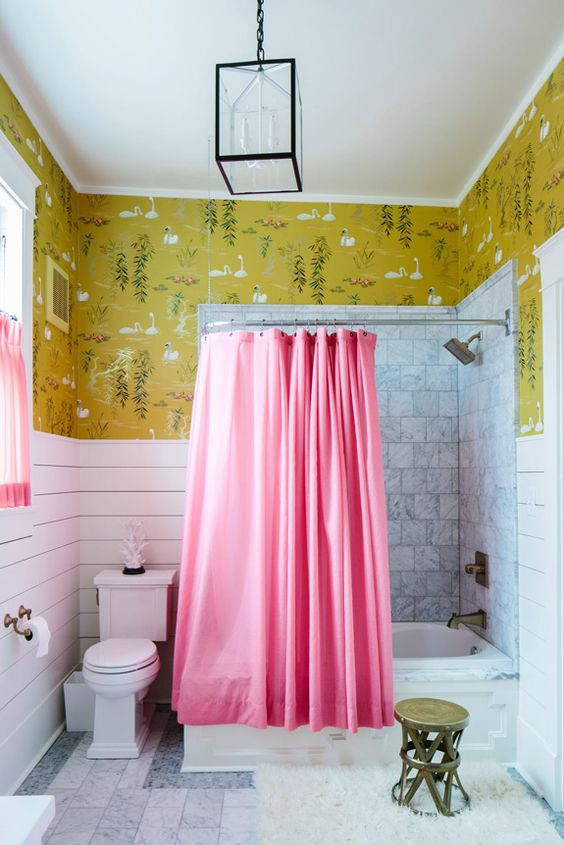 a printed wallpaper looks great in this bathroom