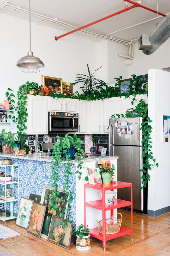 a red kitchen cart is a perfect addition to a maximalist interior