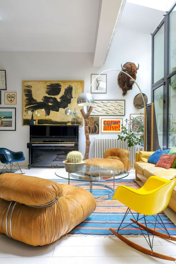 a living room with a bright yellow sofa