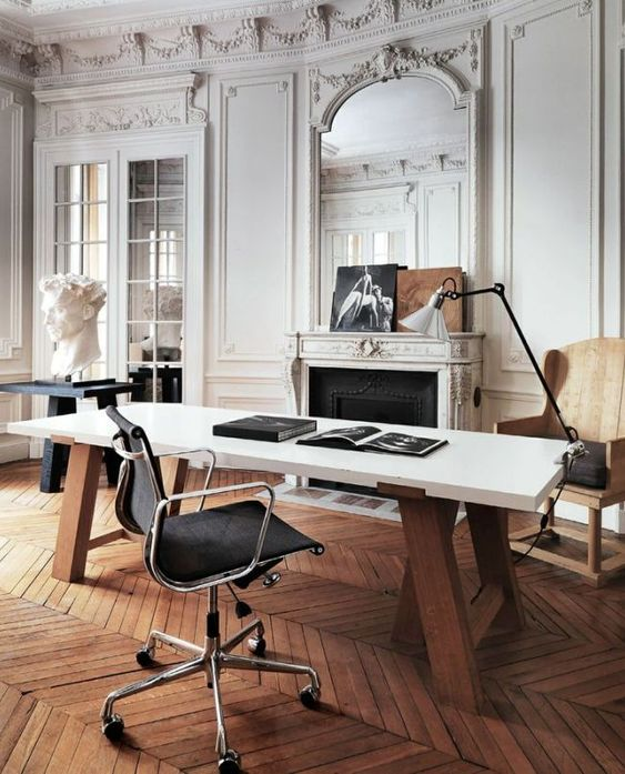 home office with a styled non-working fireplace