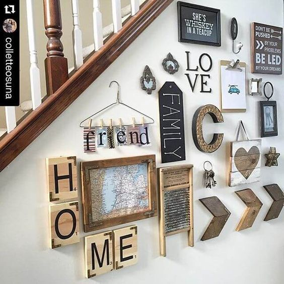 a rustic gallery wall with wooden plaques, monogrames, signs in frames and a map is a cute and lovely idea