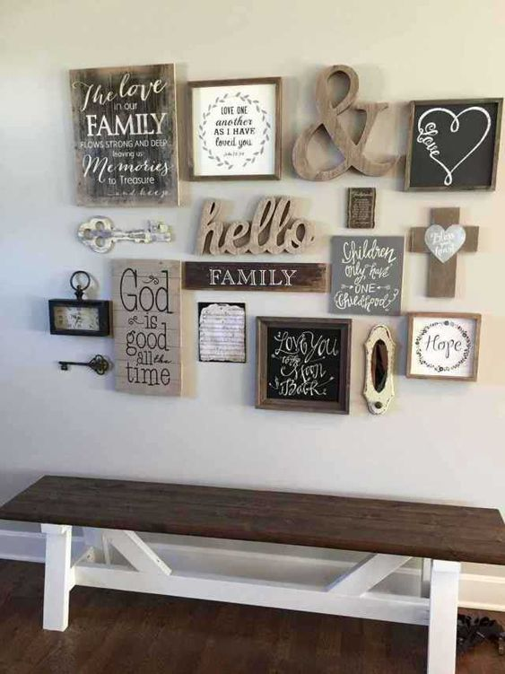 a shabby chic and rustic gallery wall with vintage keys, clocks, signs, an ampersand and chalkboard in a frame is cool
