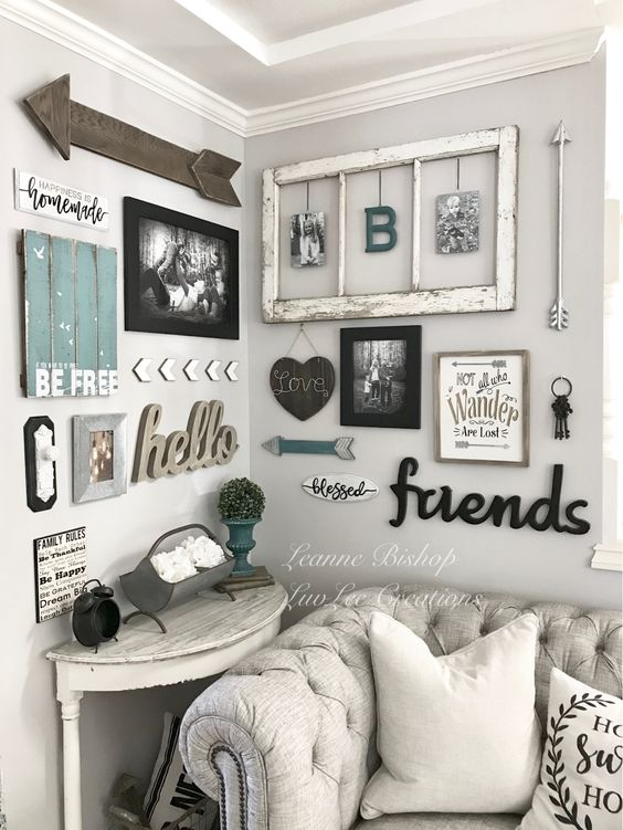 a shabby chic rustic gallery wall with a window frame, calligraphy, photos in frames, arrows and signs is cool