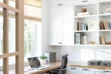 03 a modern farmhouse home office with white shaker kitchen cabinets, a floating desk and shades plus a printed rug