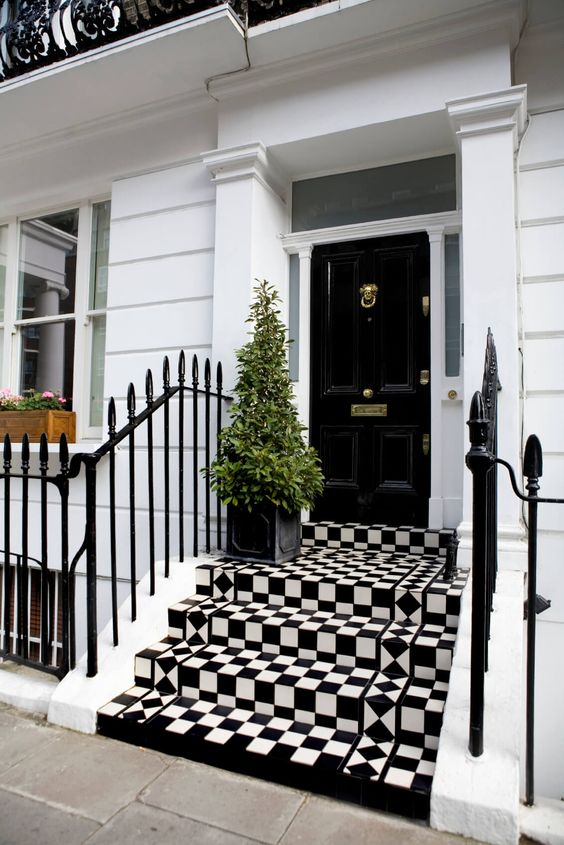 a modern front porch with a geometric flooring