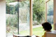 10 a corner window with a daybed and printed bedding allows natural light, views and even an exit to the garden