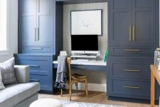 10 a stylish home office done with navy kitchen cabinets, a pastel blue sofa and faux fur stools, gold touches for more elegance