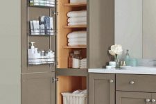 12 a stylish and chic farmhouse bathroom done with taupe kitchen cabinets for storage and a vanity formed of them, too