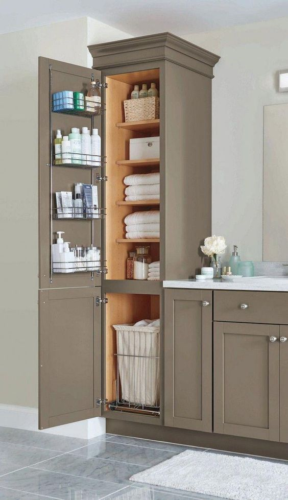 a stylish and chic farmhouse bathroom done with taupe kitchen cabinets for storage and a vanity formed of them, too