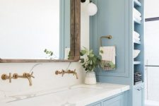 13 a lovely coastal bathroom done with light blue kitchen cabinets and a vanity that matches, with a white stone countertop