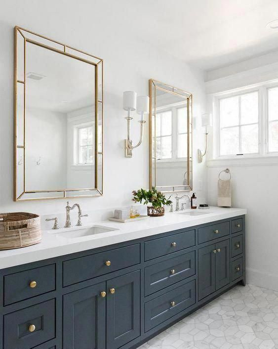 an elegant graphite grey farmhouse bathroom with a double sink and mirror, with a basket for storage
