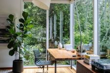 a gorgeous home office with floor to ceiling windows
