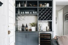 a gorgeous home bar made of kitchen cabinets