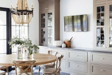34 a beautiful farmhouse dining room done with grey kitchen cabinets, a wooden dining set and a wooden bead chandelier