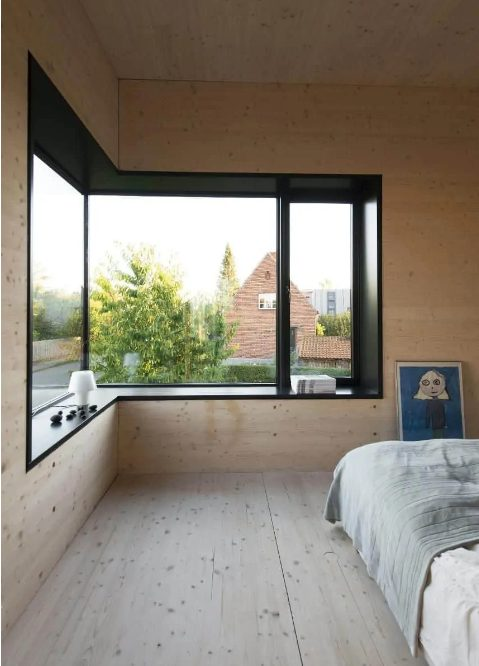 a welcoming and natural bedroom with a corner window and a windowsill used for storage is a good idea to fill your space with natural light