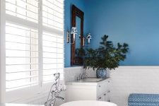 a cool bathroom design with a blue wall