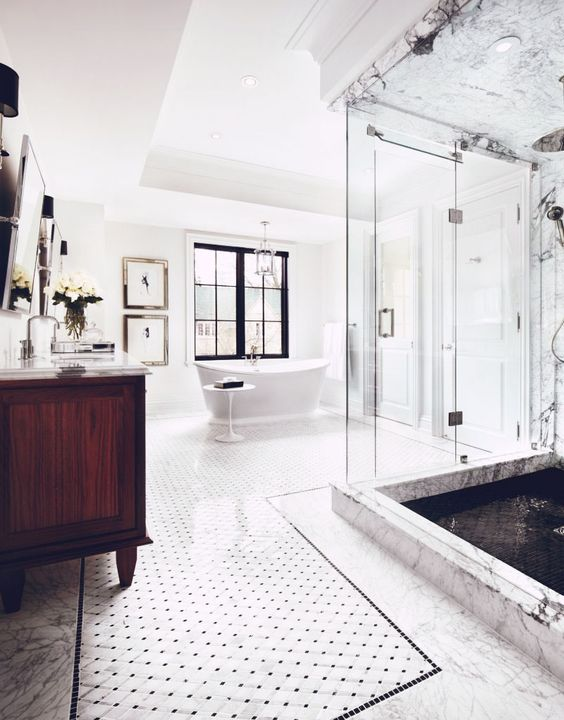a spacious bathroom with a glass-enclosed shower space