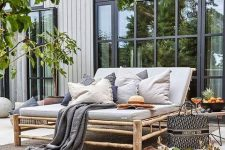a cool deck with rattan furniture