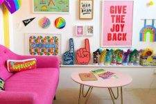a colorful living room with a hot pink sofa, a blush table, a colorful gallery wall and a rainbow decoration is pure fun