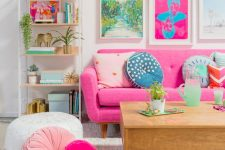 a cute living room with lots of cool color accents