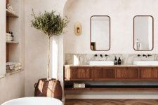 a modern country bathroom with white walls and a ceiling, a stained chevron floor, a stained vanity and arched niches is lovely