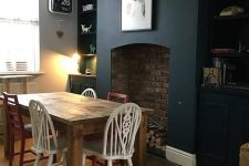 a dining space with a black wall