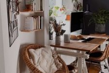 a modern country home office with a trestle desk, rattan chairs, floating shelves, a memo grd and some cool potted plants