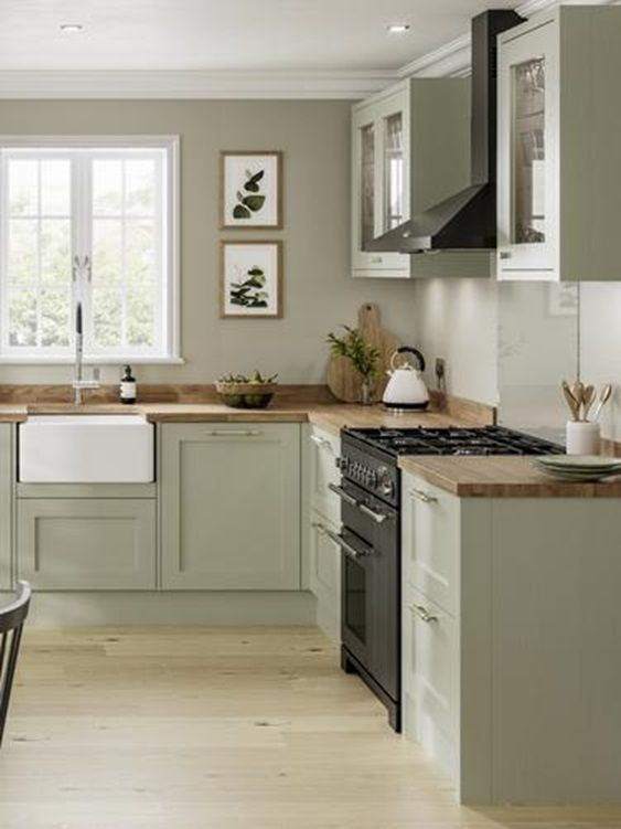 a modern country kitchen in olive green, with grey walls, butcherblock countertops and lovely botanical prints is a lovely idea