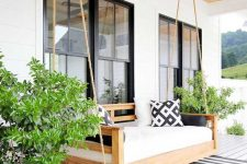 a daybed is the best addition to a porch