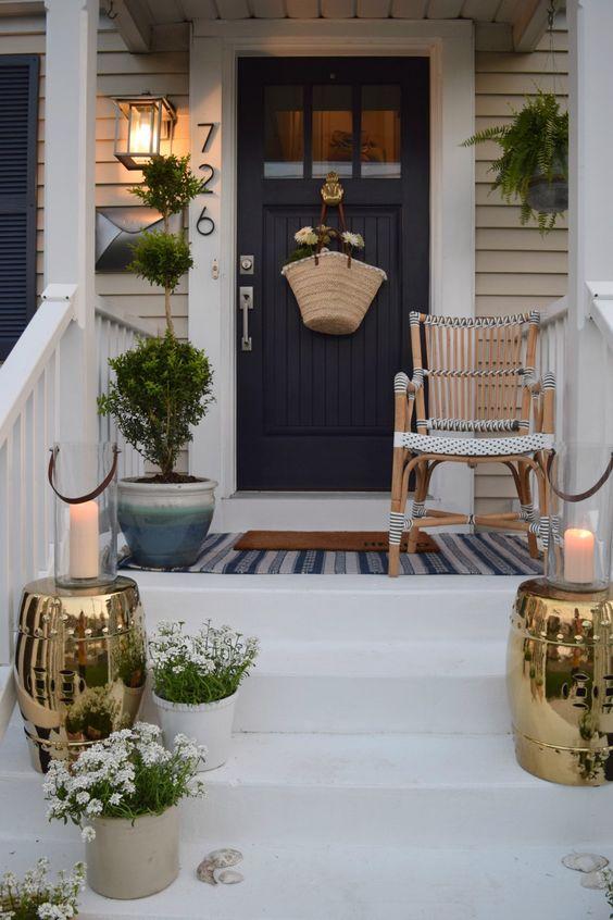 a small porch designed in farmhouse style