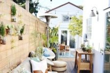 a small but cozy terrace with greenery on a wall