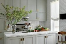 a country kitchen with subway tiles