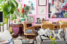 an eclectic space with a hot pink accent wall and a gallery wall, quirky and mismatching furniture, lots of potted plants and blooms and printed pillows