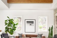 a spacious living room with exposed wooden beams