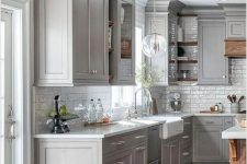 09 a modern farmhouse grey kitchen with white stone countertops and a white subway tile backsplash, with neutral fixtures is chic