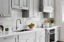 10 a beautiful dove grey modern farmhouse kitchen with a white Moroccan tile backsplash and white stone countertops plus neutral fixtures